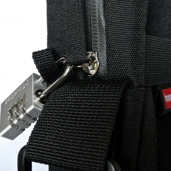 When the bag is zipped closed, a small travel-size padlock can be placed through the zipper and left side accessory loop to deter theft of items inside of bag.