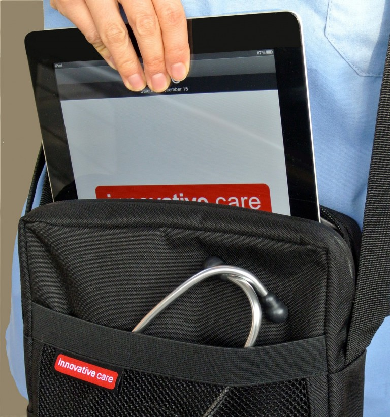 The iPad or tablet easily slides into the padded inside pocket.